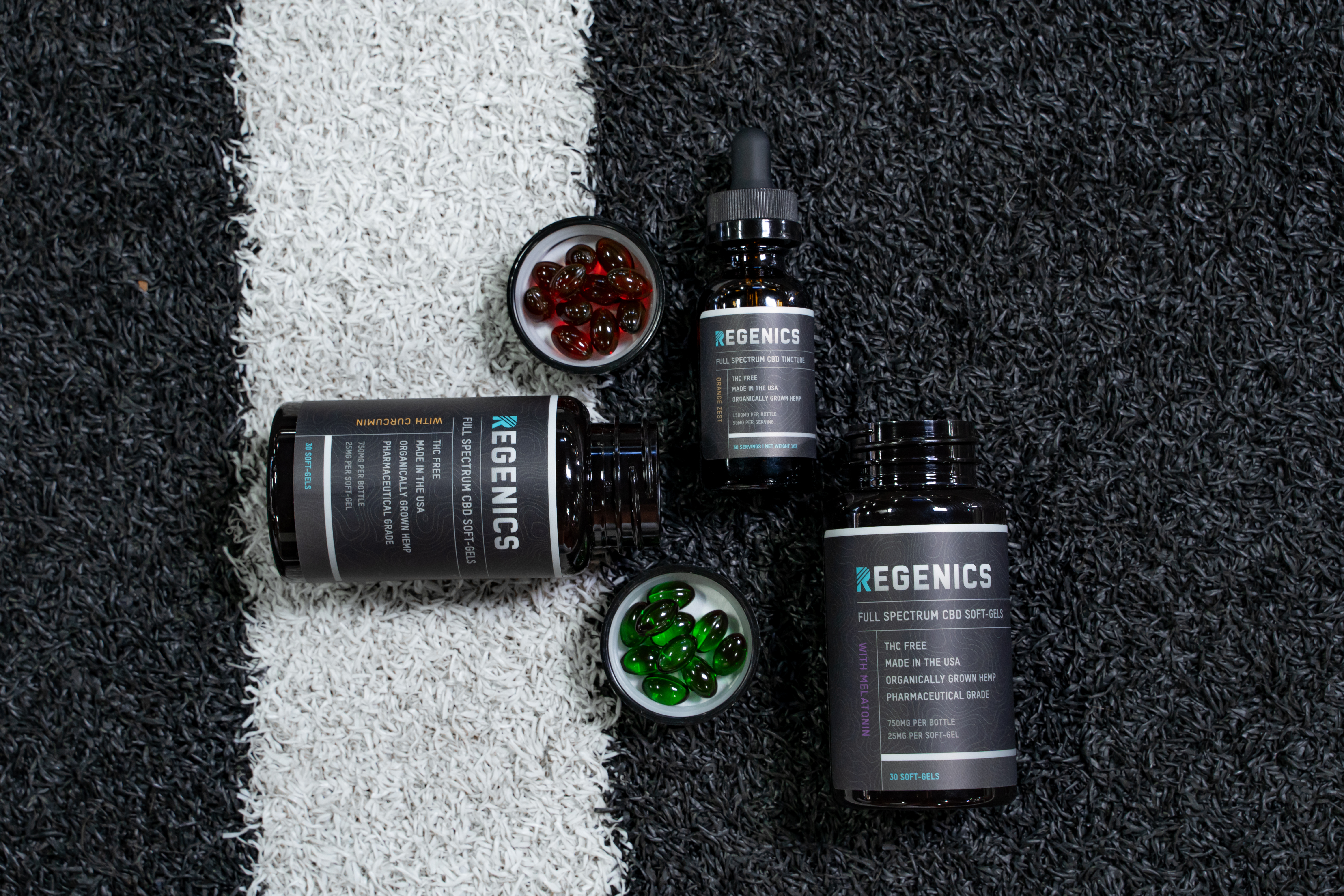 Assortment of CBD soft-gels and tinctures